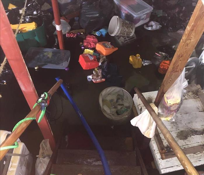 flooded basement with waste floating