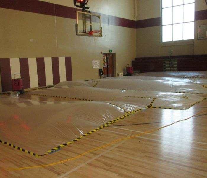 gym floor being dried using safe practices